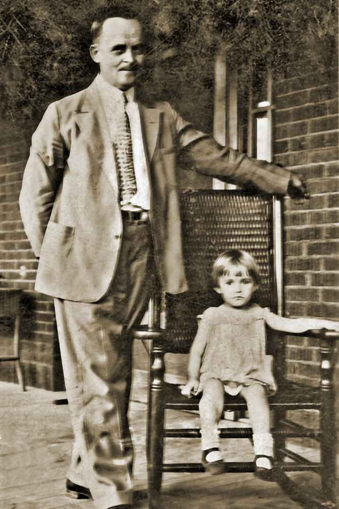 Betty with her father on the porch