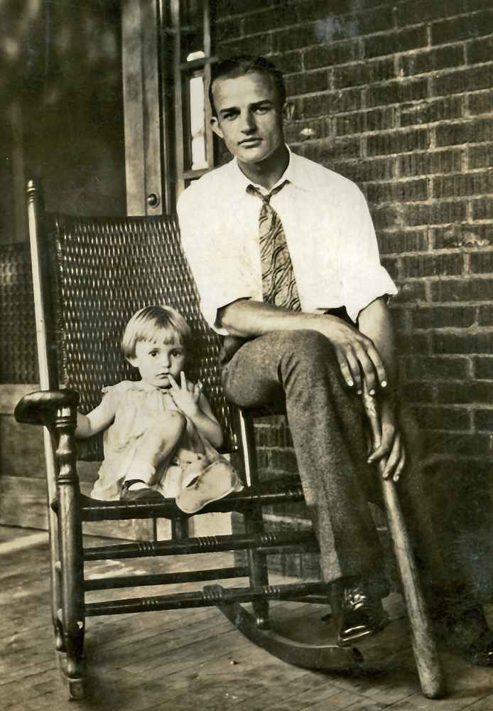 Betty with Shuford on porch