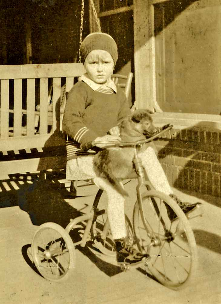 Betty with dog on tricycle