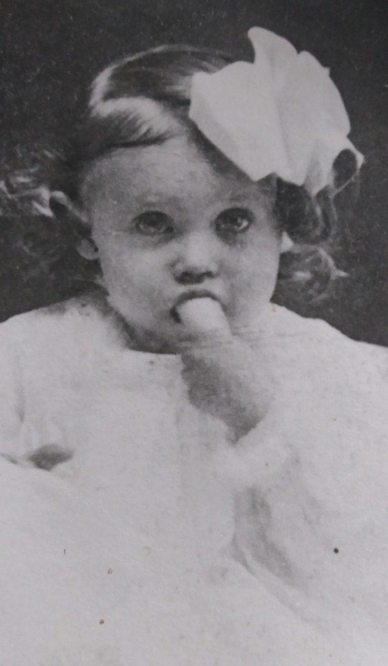 Mary Kathleen as a little girl eating a banana